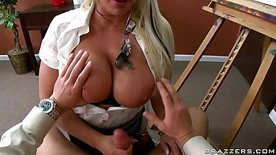 Blonde office slut Sadie titty fucks a cock between