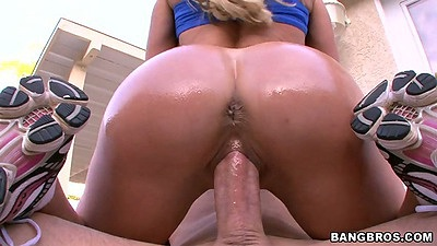 Big round ass Brandi Love sits on dick with oil all over ass riding
