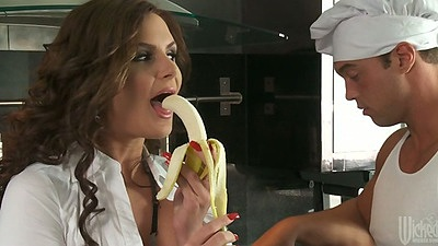Redhead milf Phoenix Marie eating a banana in the kitchen and sucks